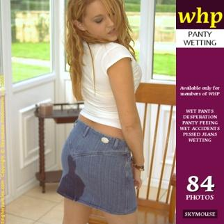 Kira pees her panties and denim skirt while sitting on the chair