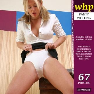 naughty schoolgirl Sadie wets her knickers while you look up her skirt!